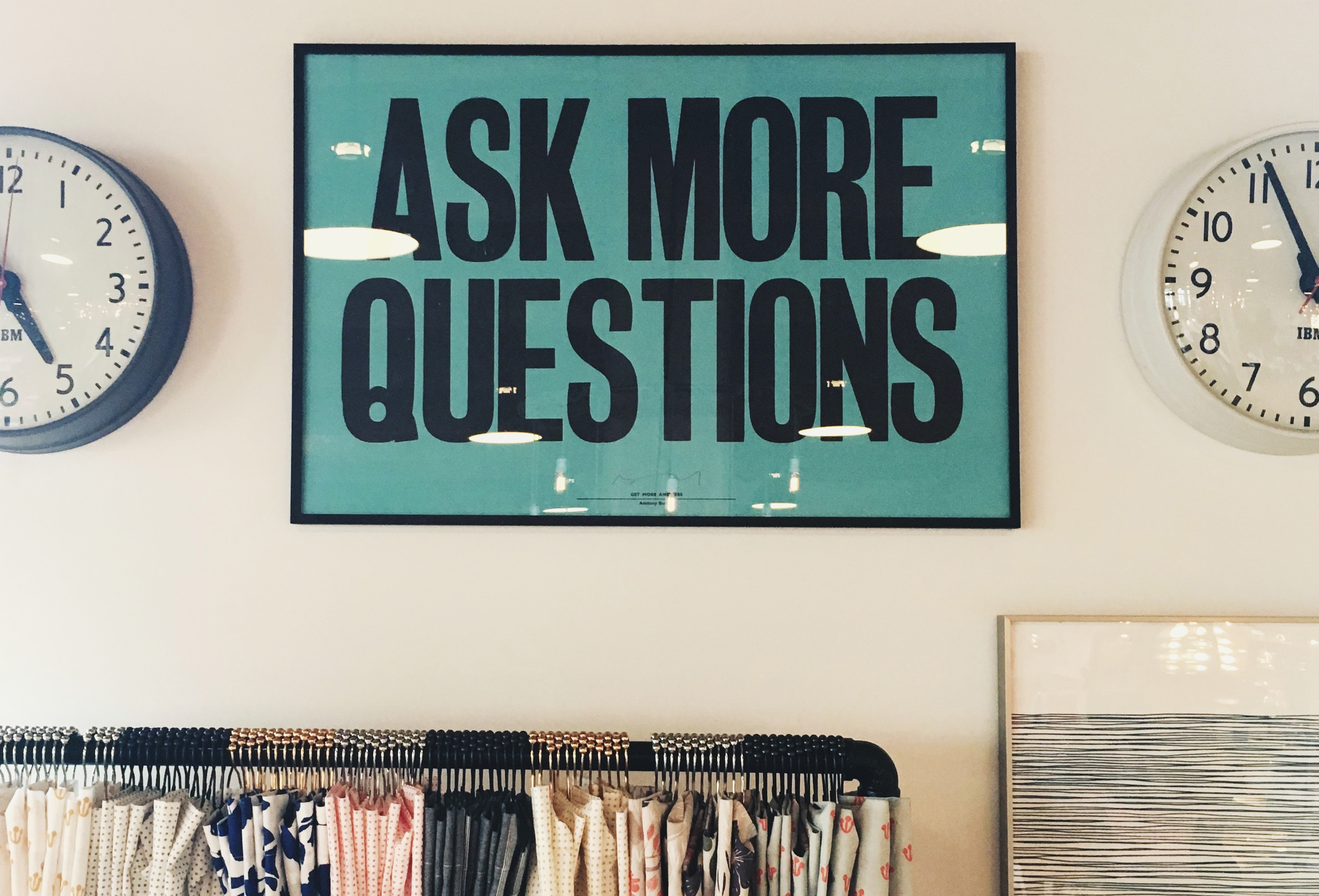 sign in a classroom that reads ||ask more questions||